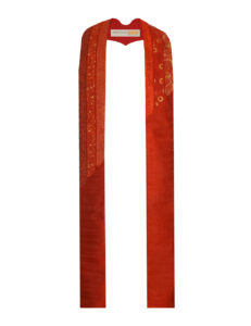 The Cascade Stole has six individual strips of red cottons with curved ends that cascade down the stole.