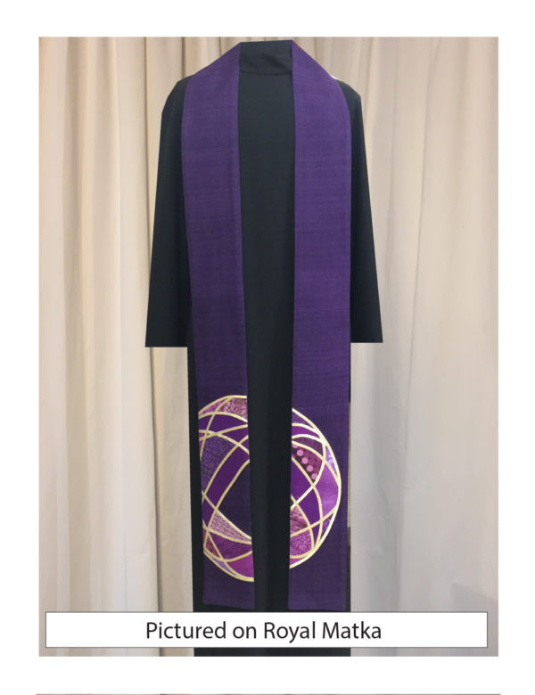 Overlapping circles and ovals of gold lame' and a variety of purple cotton prints and batiks on a base of silk dupioni suggests a globe and cross.