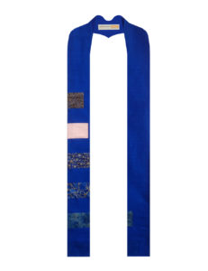 Advent Candle stole with blocks of blue and pink cotton on a blue silk background.