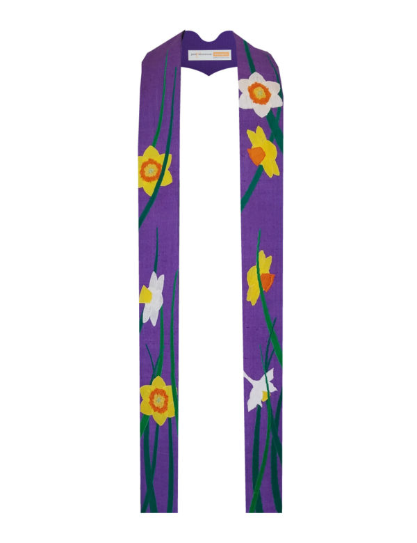 Stylized white and yellow daffodils are strewn across a base of purple silk matka in this beautiful springlike stole.