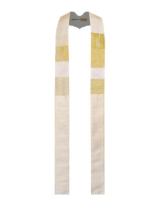 This cream stole has chest-high panels of pieced cottons on a base of solid silk.