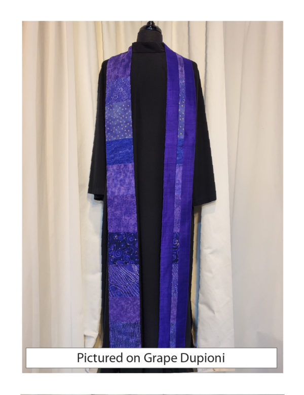 A panel of pieced purple cottons on one side and a matching strip of cottons against a silk dupioni base on the other.