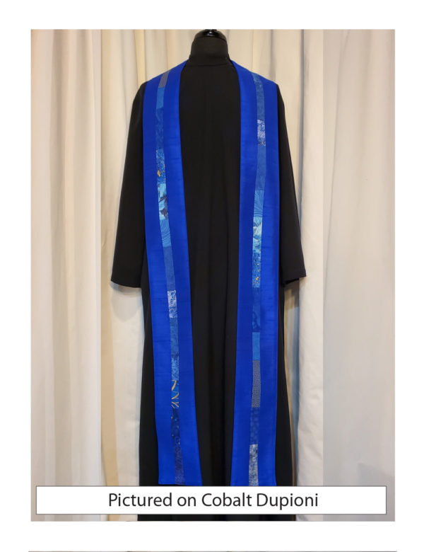 Cobalt silk dupioni with elegant strips of pieced cotton prints and batiks centered on both sides of this stole.