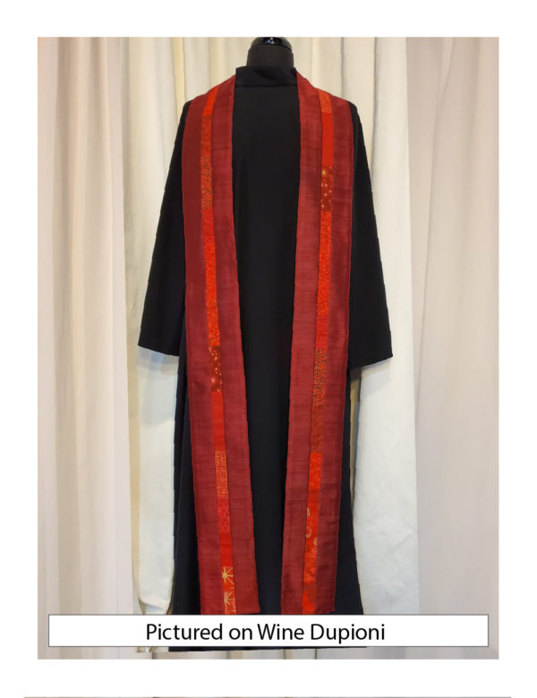 Wine silk dupioni with elegant strips of pieced cotton prints and batiks centered on both sides of this stole.