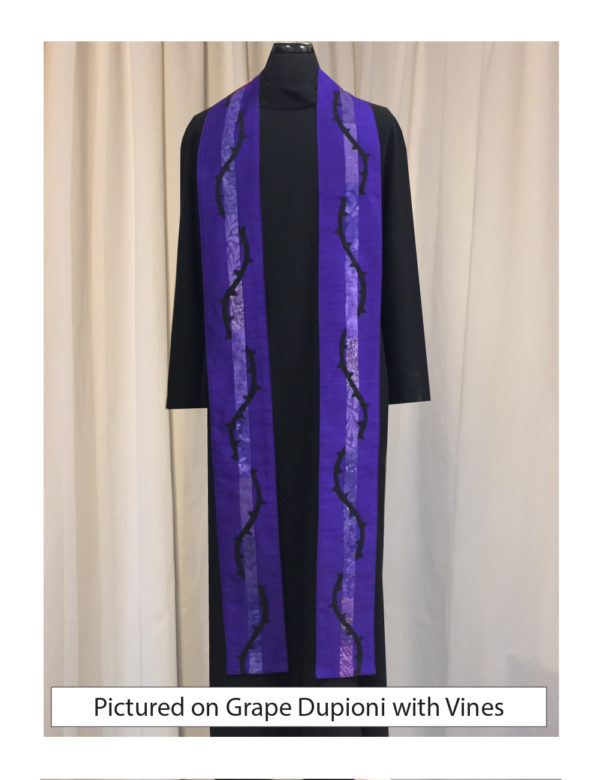 Grape silk dupioni with elegant strips of pieced cotton prints and batiks centered on both sides of this stole accented with a vine of thorns wrapping around the center cotton stripe.