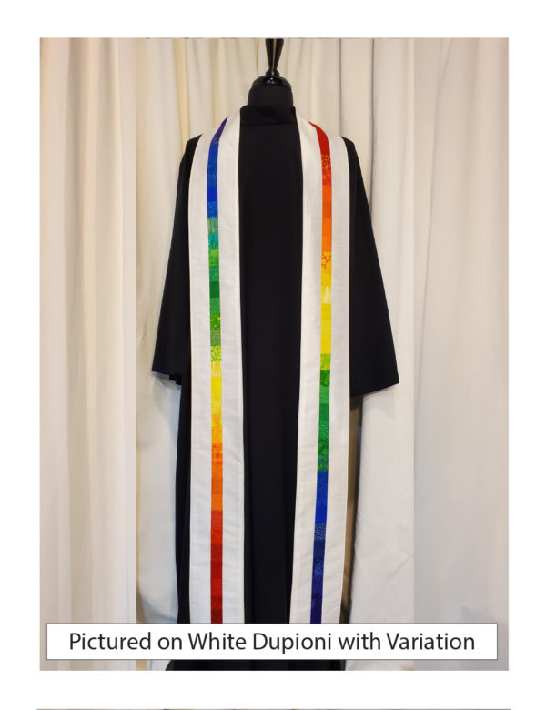 White silk dupioni with elegant strips of pieced cotton prints and batiks in rainbow colors centered on both sides of this stole.