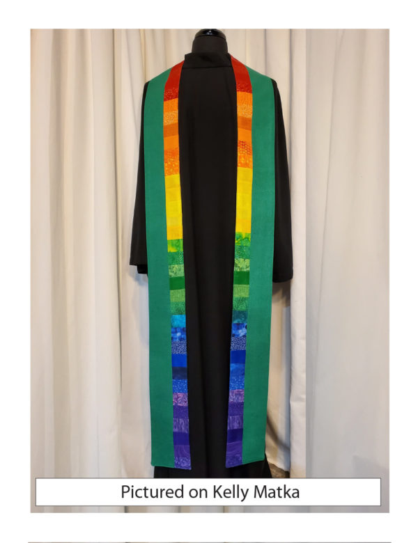 Strips of pieced cottons in a rainbow pattern down the inside edge of this Galilee stole.