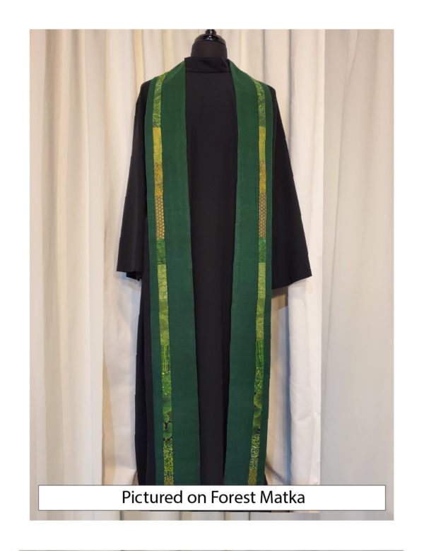 Slender strips of pieced green cottons run down each side of the Iona stole, placed slightly outside the center line, on a base of forest green matka.