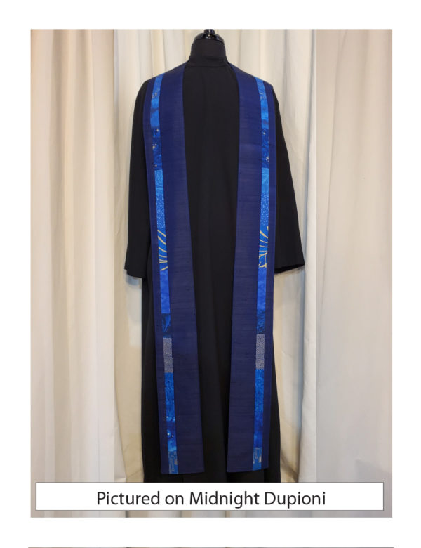 Slender strips of pieced blue cottons run down each side of the Iona stole, placed slightly outside the center line, on a base of midnight blue dupioni.