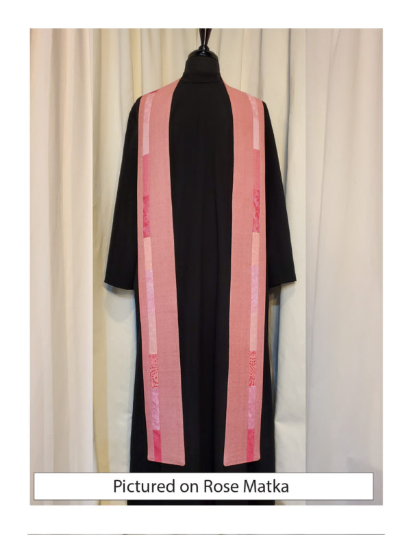Slender strips of pieced pink cottons run down each side of the Iona stole, placed slightly outside the center line, on a base of pink matka.