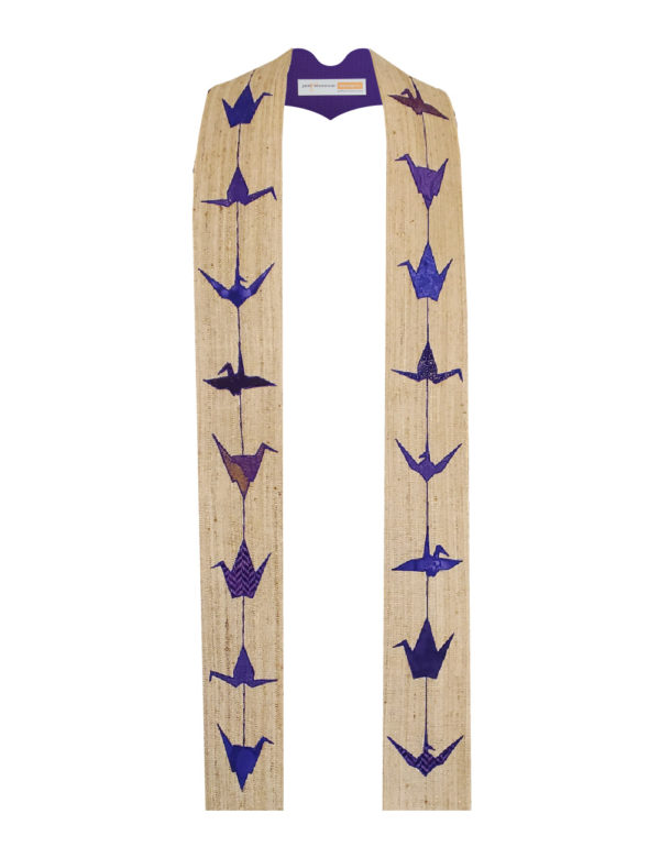 This stole is inspired by strands of Japanese origami cranes. Five different crane silhouettes in purple and blue cottons on a flax silk matka base.