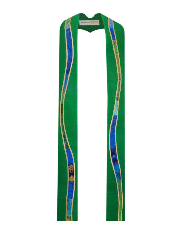 """Kelly green silk dupioni is embellished with gently meandering """"rivers"""" of a selection of cottons in a range of prints, solids, and batiks in blue and green tones outlined with gold lame'."""