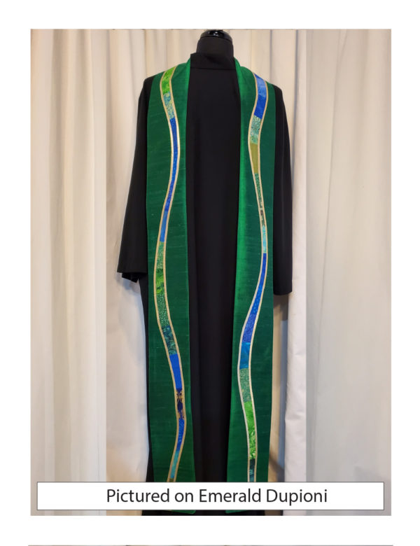 "Emerald green silk is embellished with gently meandering ""rivers"" of a selection of cottons in a range of prints, solids, and batiks in blue and green tones outlined with gold lame'."