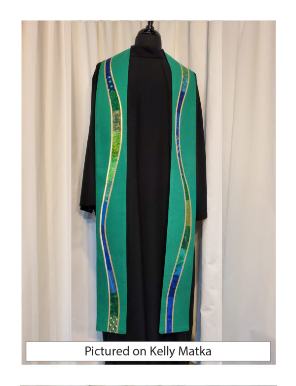 """Kelly green silk matka is embellished with gently meandering """"rivers"""" of a selection of cottons in a range of prints, solids, and batiks in blue and green tones outlined with gold lame'."""