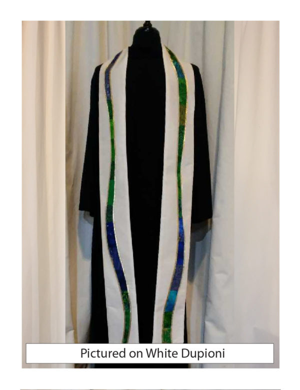 """White silk dupioni is embellished with gently meandering """"rivers"""" of a selection of cottons in a range of prints, solids, and batiks in blue and green tones outlined with gold lame'."""