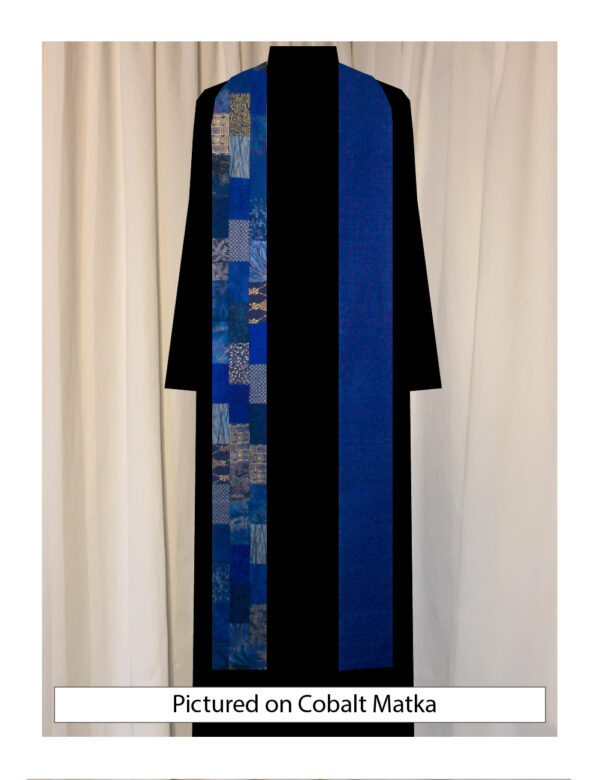 Offset rectangles of a wide variety of cotton prints and batiks stairstep down one side of this stole, balanced by solid silk on the other side.