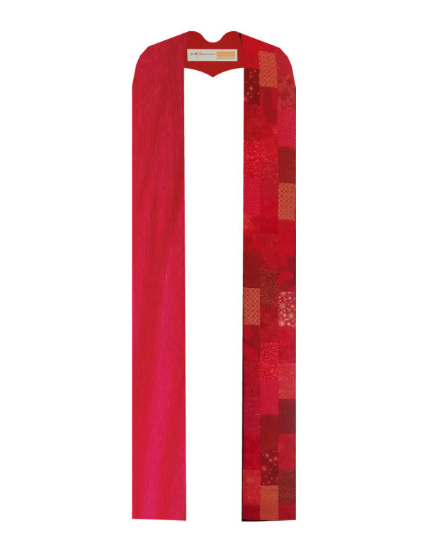 Offset rectangles of a wide variety of red cotton prints and batiks stairstep down one side of this stole, balanced by solid silk on the other side.