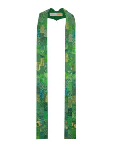 Offset rectangles of a wide variety of green cotton prints and batiks stairstep down both sides of this Lystra B stole.