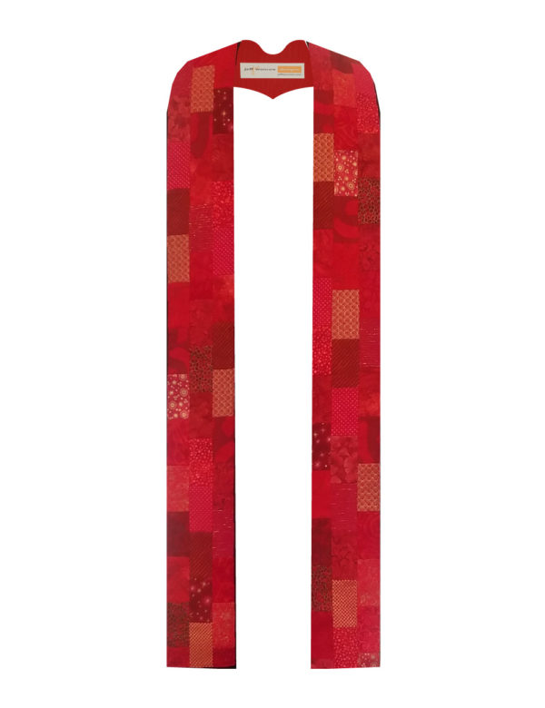 Offset rectangles of a wide variety of red cotton prints and batiks stairstep down both sides of this Lystra B stole.