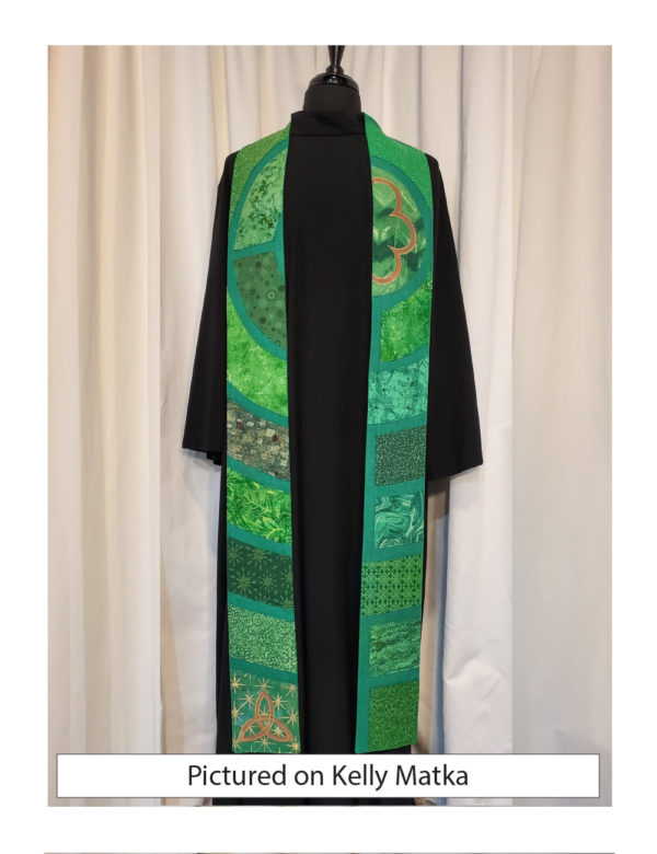 This stole is a slice through the center of a classic Chartres labyrinth showing segments of the path in a variety of green cottons with gold accents.