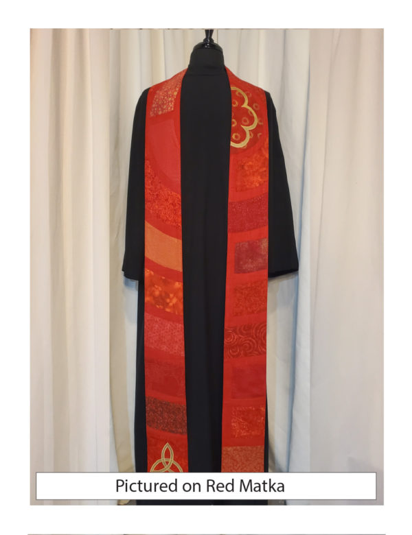 This stole is a slice through the center of a classic Chartres labyrinth showing segments of the path in a variety of red cottons with gold accents.