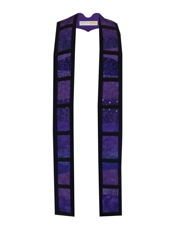 Undulating pieces of purple cotton prints and batiks within a grid of black cotton bars create a strong yet subtle design.
