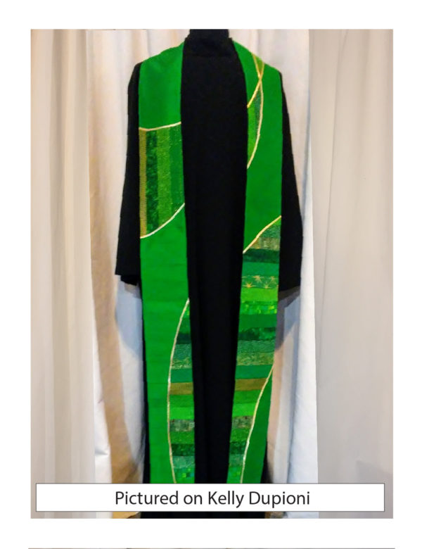Panels of pieced green cotton are cut into a swooping design suggesting the double helix of a DNA molecule. A green base and gold accents complete the look.