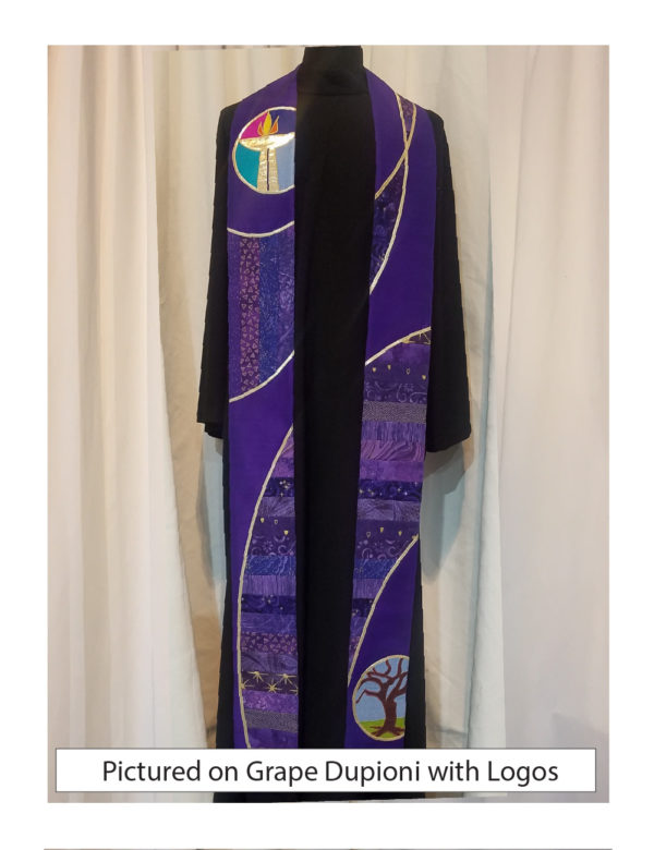 Panels of pieced purple cottons are cut into a swooping design suggesting the double helix of a DNA molecule. A purple base and gold accents complete the look.
