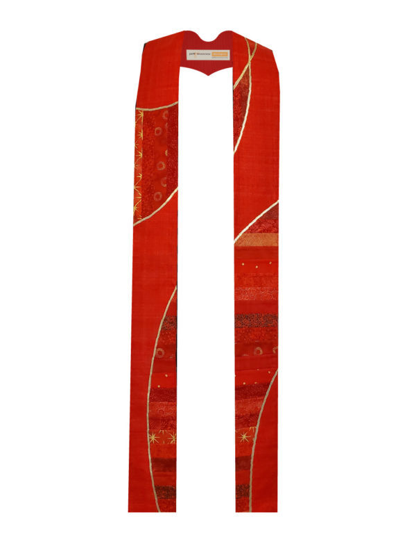 Panels of pieced red cotton are cut into a swooping design suggesting the double helix of a DNA molecule. A red base and gold accents complete the look.